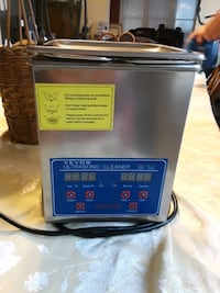 Ultrasonic cleaner with temperature control.  Has metal basket inside.