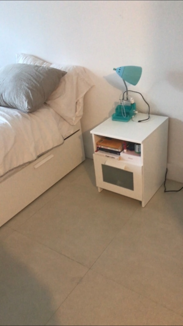 White  wooden drawer nightstand