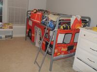 Loft bed frame - twin with fire truck curtain