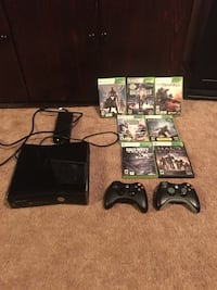 Black xbox with controllers and game cases Winnipeg, R3J 1R3